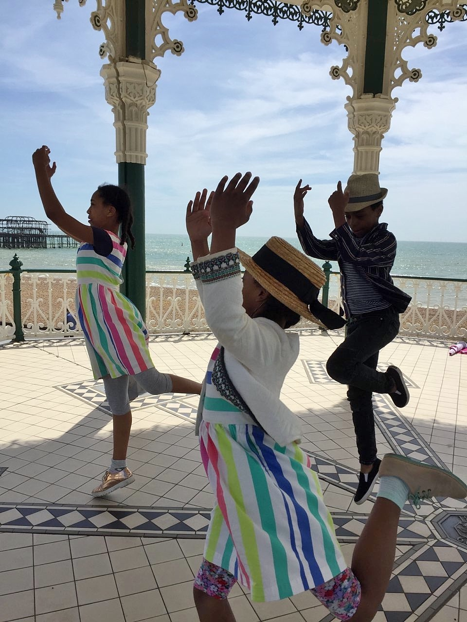 Dance trio in bandstand.
