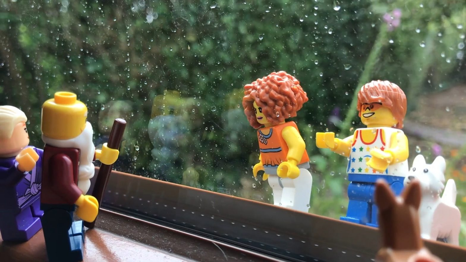 Lego scene set between a window pane.