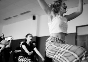 Dancers praticising their routine in the studio.