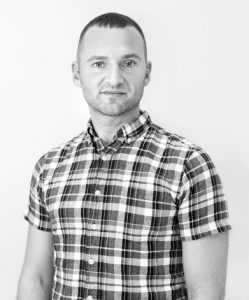 Photograph of Stuart Waters wearing a plaid shirt.