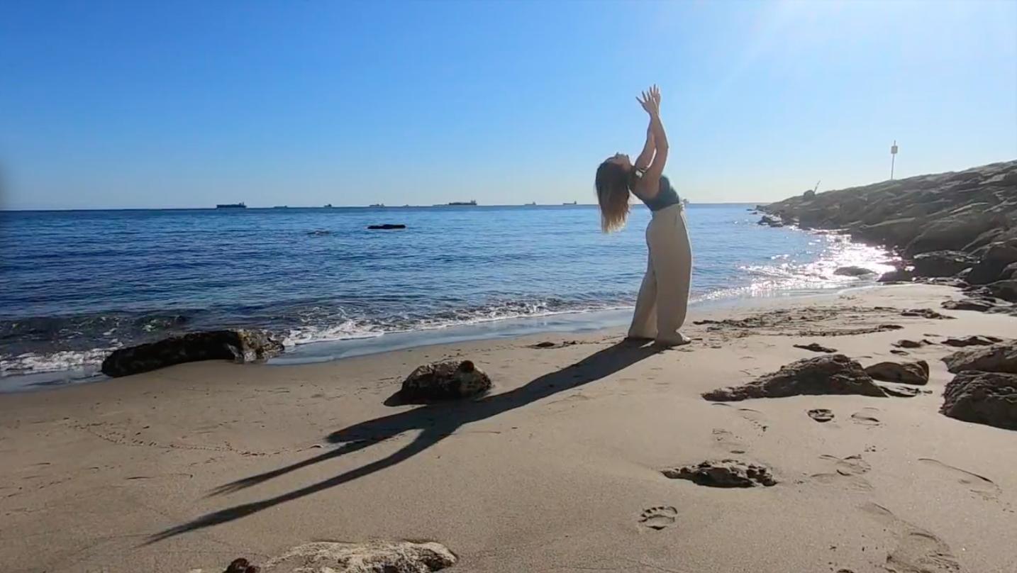 Dancer on sandy beach