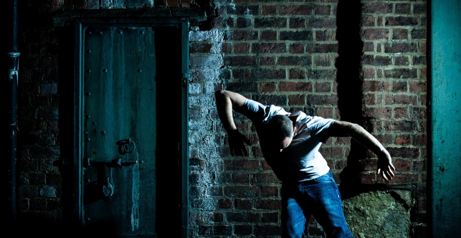 Urban setting with man performing contemporary dance.