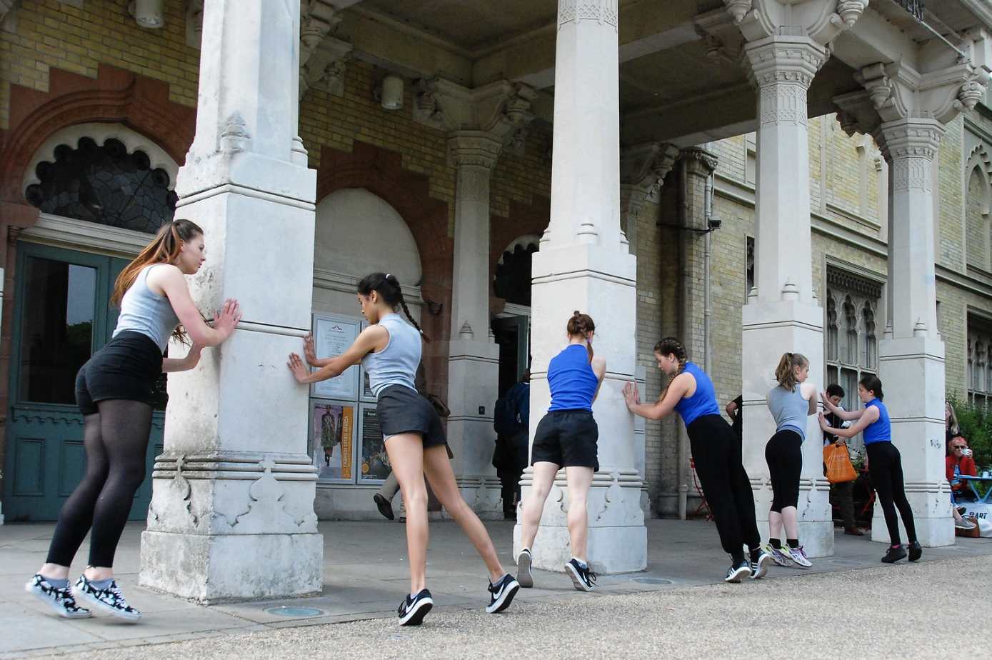 Dancers exercising outdoors.