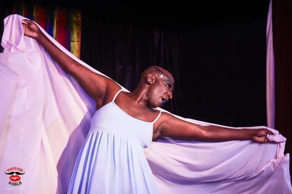 Headshot of Ebony Rose Dark aka Mickel performing.