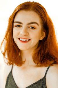 Headshot of Corrie McKenzie.